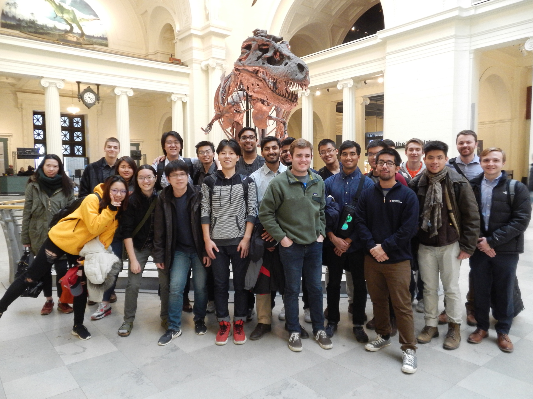 group of students with Sue the T-Rex