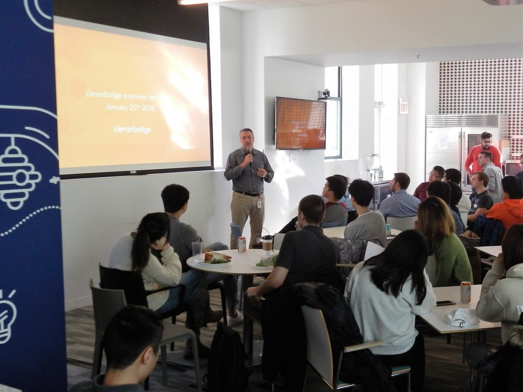 Cleverbridge co-founder and Illini Engineer Craig Vodnik welcomes the group to the Chicago office.