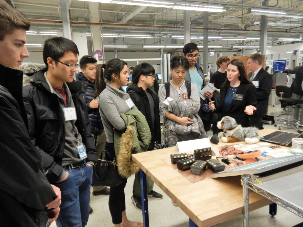 students looking at a product demonstration