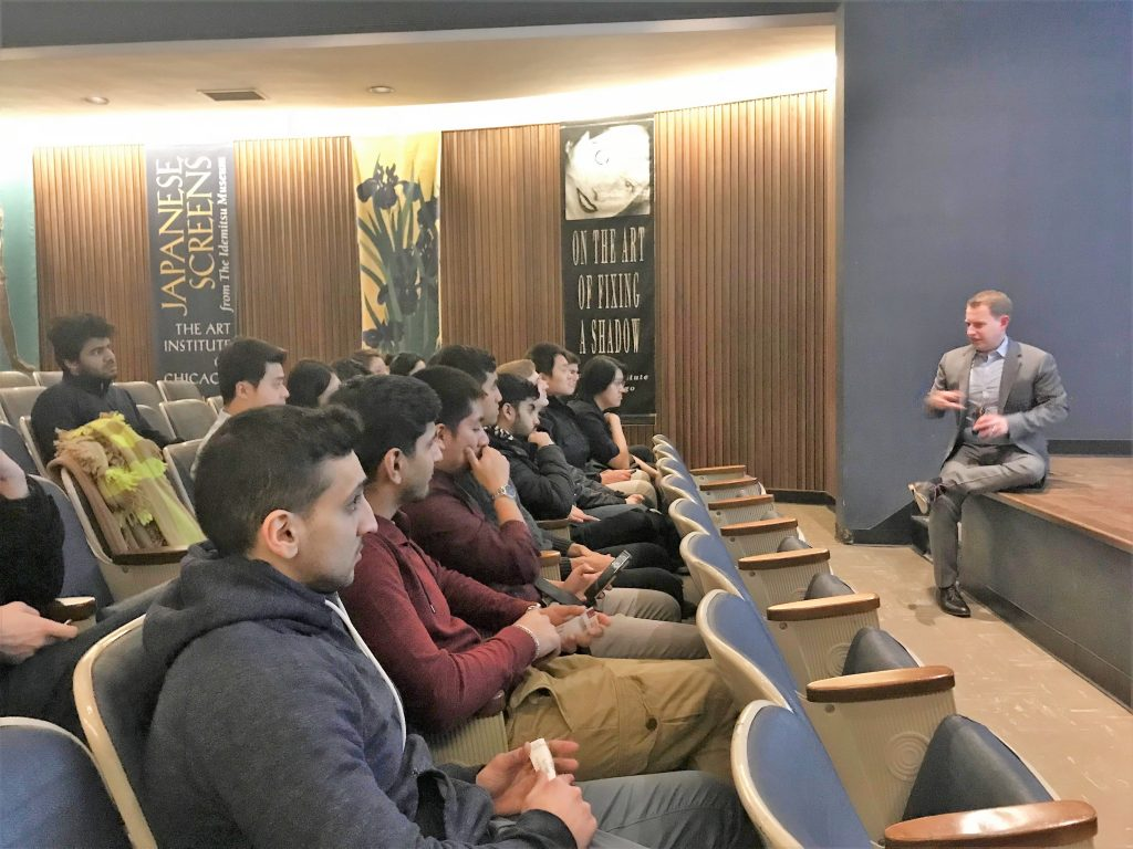 speaker talking to room of students